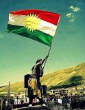 Kurdistan Flag held by a kurd